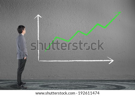Business man looking business growing green graph