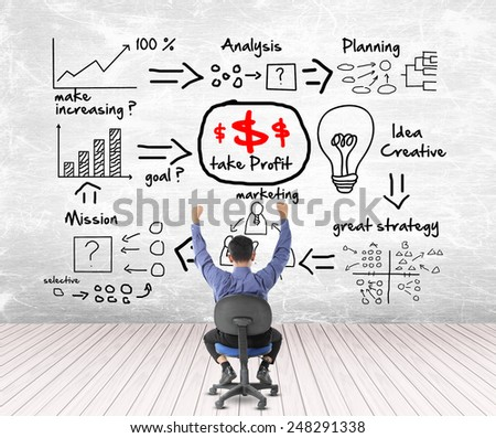 Business man looking success with profit concept - stock photo