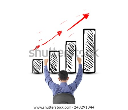 Business man looking success with profit graph - stock photo