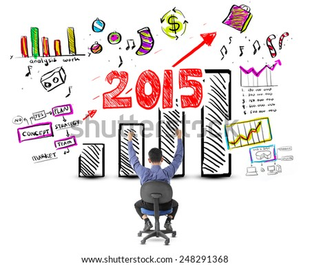 Business man looking success with profit graph in year 2015 - stock photo