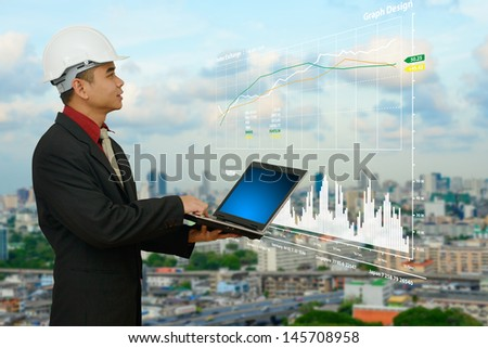 Business man looking to the graph and future - stock photo