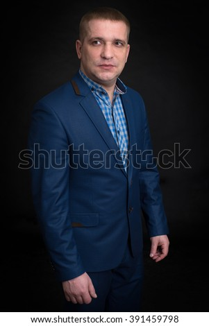 Business man looking up against dark background