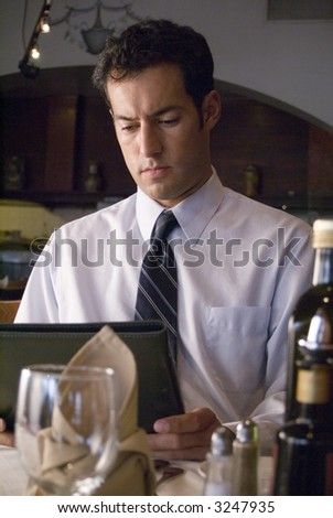 Business man looks at a menu