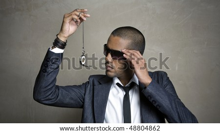 Business man looks at the time on his watch - stock photo