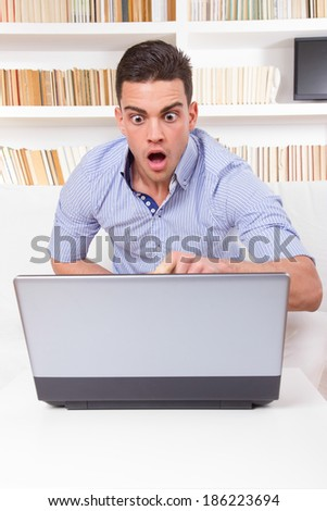 business man looks surprised at content on computer monitor failure, hacked stolen password - stock photo