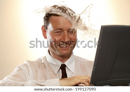 business man looks to notebook and water splash - stock photo