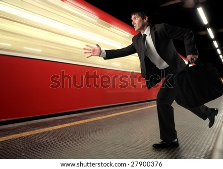 Business man loosing the train - stock photo