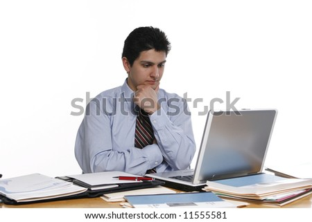 Business man lost in contemplation as he stares at his laptop. Isolated against a white background - stock photo