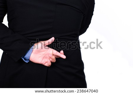 Business man lying fake hand Fingers Crossed  - stock photo