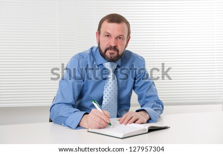 business man making notes - stock photo