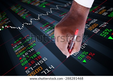 Business man marking the stock chart - stock photo