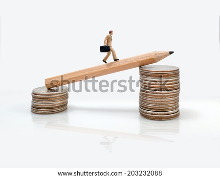business man miniature figure concept move to success business finance and marketing - stock photo