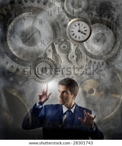 business man moving gear of big clock