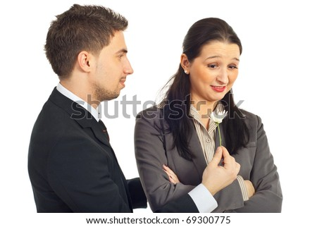 Business man offering a flower to a rude crooked woman  isolated on white background