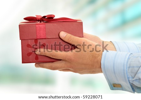 Business man offering a gift