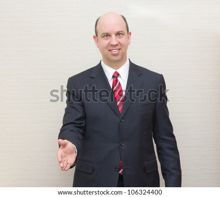 Business man offering a handshake. - stock photo