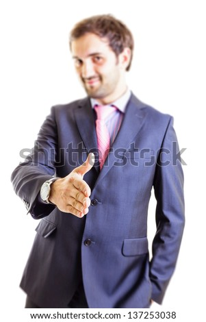 Business man offering a handshake and smile isolated on white - stock photo