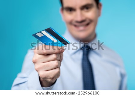 Business man offering his cash card, focus on card. - stock photo