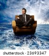 business man on armchair sail in the sea - stock photo