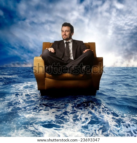 business man on armchair sail in the sea