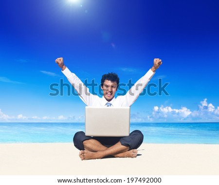 Business man on beach with laptop. - stock photo