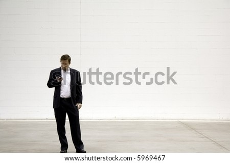 Business Man on Blackberry Phone against White Background - stock photo