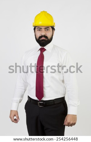 Business man on construction site isolated on white - stock photo
