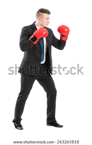 Business man on guard protecting company with his boxing skills - stock photo