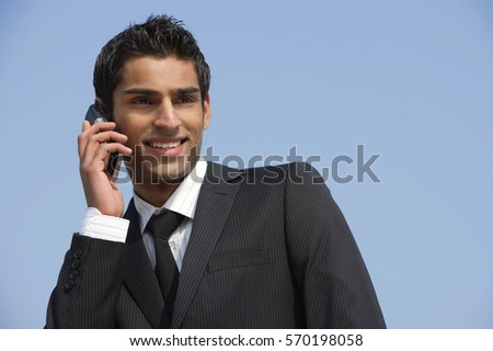 business man on phone, smiling