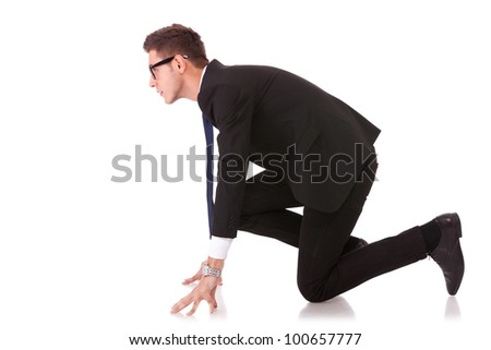 Business man on starting line of a race isolated over white background