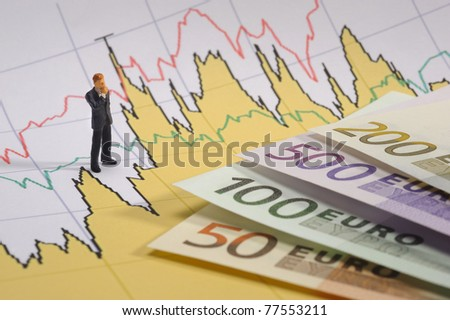business man on stock price chart - stock photo