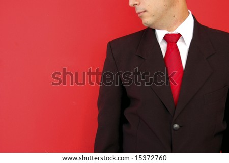 Business man  on the red background - stock photo
