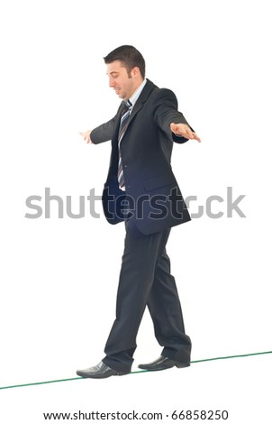 Business man on tightrope  concentrate to  walking isolatedon white background - stock photo