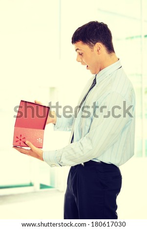 Business man opening a gift  - stock photo