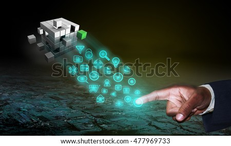 Business man operating software application technology, the cube represents as solution for the business problems.