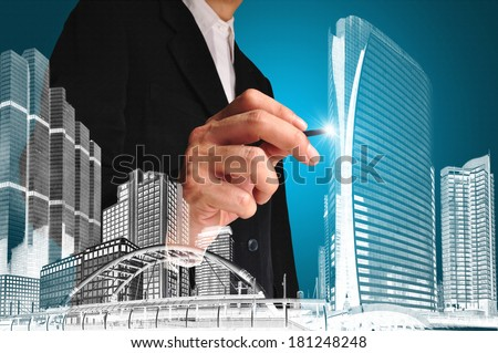 Business man or achitect draw the drawing of building or cityscape - stock photo