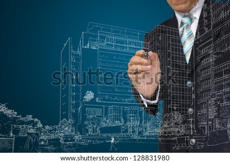 Business Man or architect draw building and cityscape