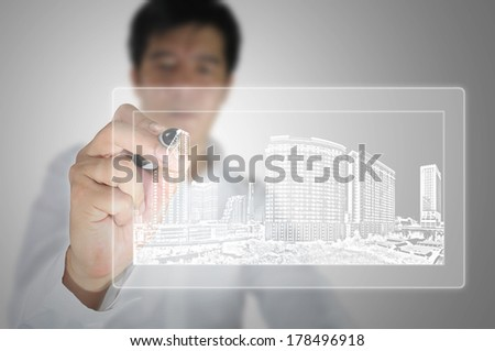 Business man or architect draw building and cityscape on gradient background - stock photo