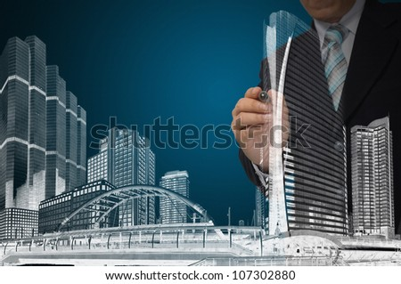 Business Man or Architect draw cityscape and building - stock photo