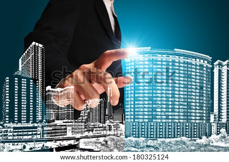 Business man or architect touch the drawing of building or cityscape - stock photo