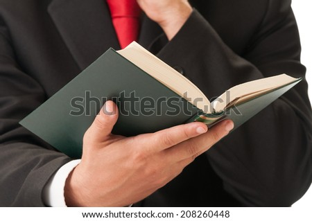 Business man or lawyer hand holding a book