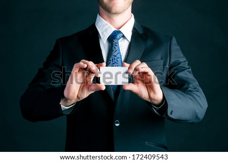 Business man or manager in suit hand over empty business card to socialize