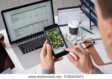 Business man ordering takeout from phone app, modern lifestyle mobile cellphone application