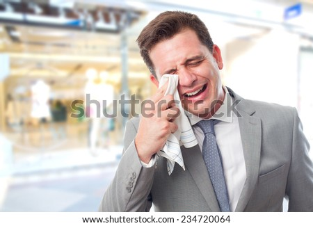 Business man over shopping center background. Looking sad - stock photo
