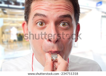 Business man over shopping center background. Using a whistle - stock photo