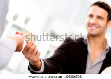 Business man paying with a credit or debit card - stock photo