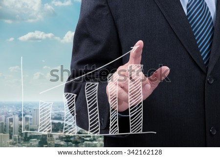 Business man point the drawing graph - stock photo
