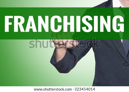 Business man point to Franchising word on green tab virtual screen - stock photo