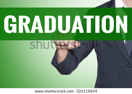 Business man point to Graduation word on green tab virtual screen - stock photo