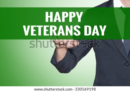 Business man point to Happy Veterans Day word on green tab virtual screen - stock photo